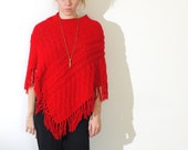 red poncho with fringe