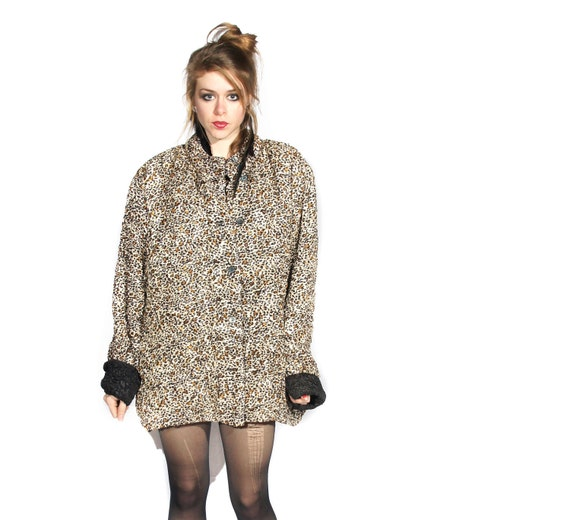 oversized leopard print and black reversible coat.