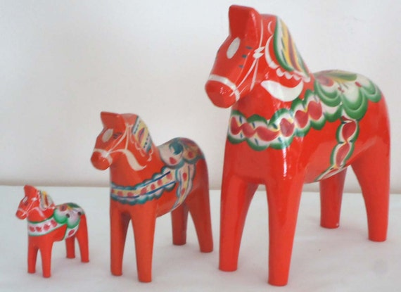 Three handcarved Dala Horses by Nils Olsson Vintage from Sweden