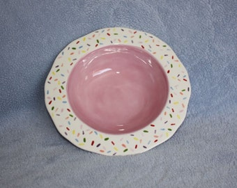Handpainted Ceramic Festive Pink Bowl with a white trim decorated with sprinkles