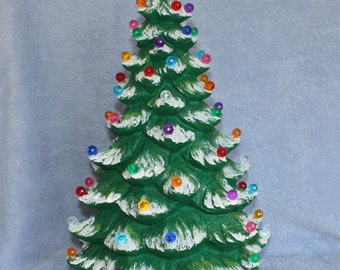 Handpainted ceramic Lighted Christmas Tree Tall with yellow star and covered in little multi colored bulbs & snow tipped branches