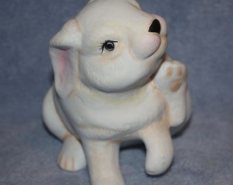 Handpainted Ceramic Bunny Rabbit in all white with little pink ears and nose, scratching is cheek