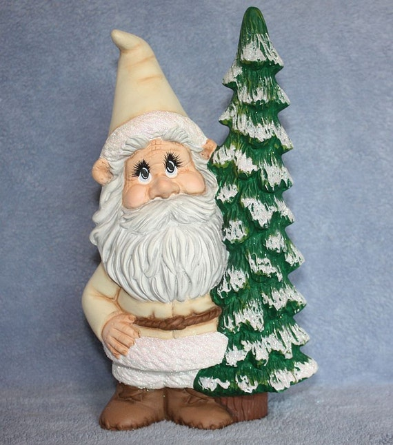 Handpainted Ceramic Winston Gnome in Winter White and holding on to a pine tree