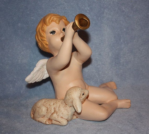 Handpainted Ceramic Large Sitting Cherub playing a horn with a little lamb cuddled up next to him