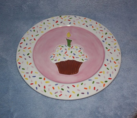 Handpainted Ceramic Festive Pink Plate with a white trim decorated in sprinkles and a chocolate cupcake in the middle