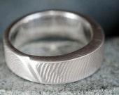 RESERVED for Alexander R. Delhougne. Carved finger-print mans ring