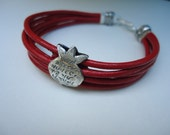 Sterling Silver Pomegranate Embraces A Red Multy Strands Leather Wrap.