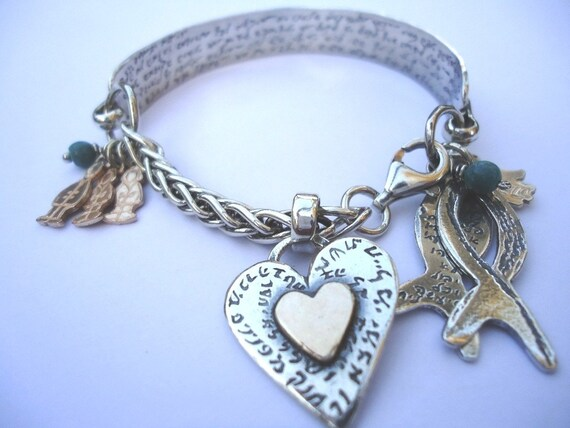 Silver Bracelet With Variety of Silver and Gold Charms