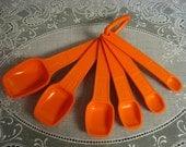 Vintage Tupperware: Tupperware Six Orange Measuring Spoons with Ring