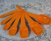 Vintage Tupperware: Tupperware Seven Burnt Orange Measuring Spoons with Ring
