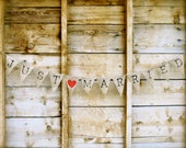 Just Married burlap Banner In Old Type Face Lettering.