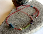lovely driftwood and peridot necklace with traditional turkish needle lace on a red cotton cord...unique and one of a kind