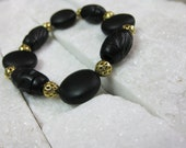 RESERVED - Black Onyx Matte Beaded Stretch Bracelet with Gold Filigree Accent Beads