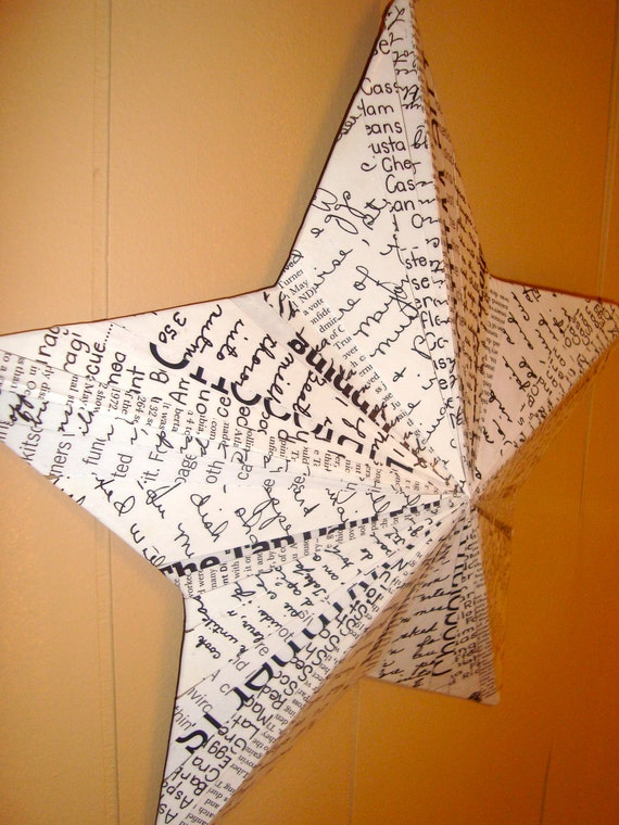 star wall hanging - black and white text
