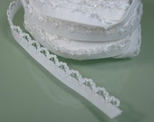 2 yds of Lacy white stretchy elastic
