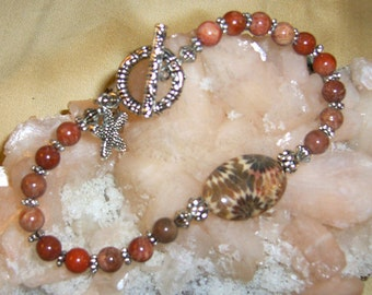 IMPRESSIONS II .... Flowery Fossil Focal, Flowery Fossil Beads, Tibetan Silver Charms and Accents