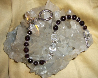 COMMITMENT .... Garnet, Swarovski Crystals, Tibetan Silver Charms and Accents