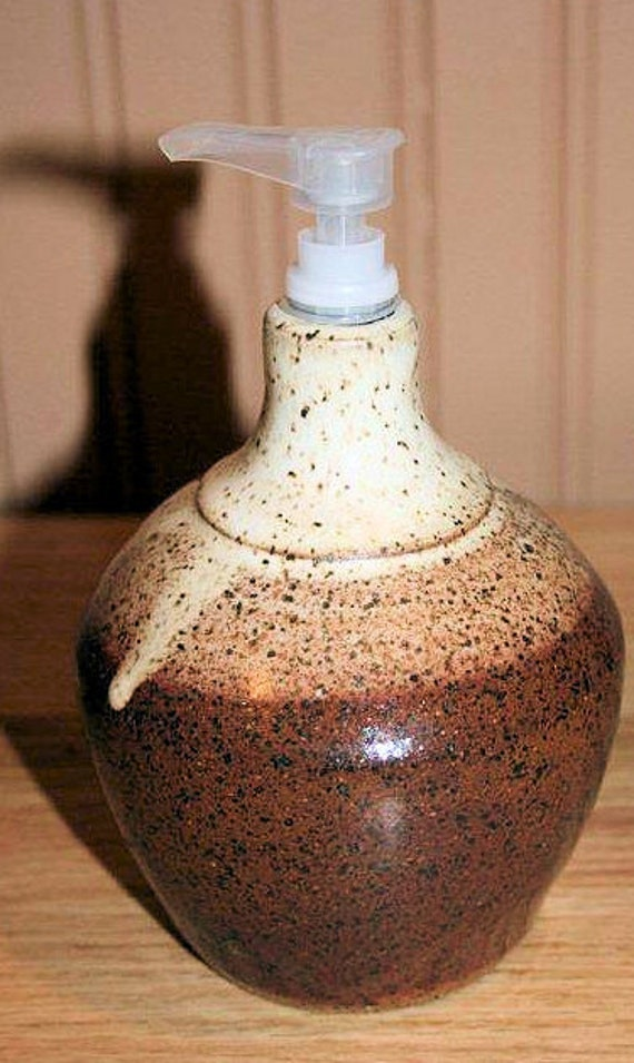 Pottery soap or lotion dispenser in brown and cream