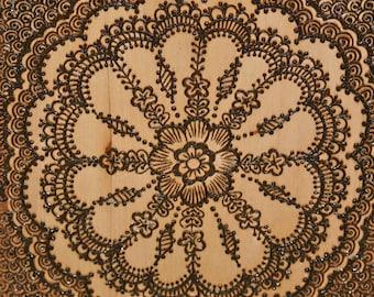 Henna Mandala On a Wood Slice