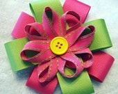Pink and Green Ribbon Flower with Yellow Button Center