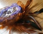 Rust orange, purple, leopard fabric flower with orange feathers and Swarovski crystals