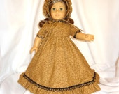 Goldish brown print, long dress for 18 inch dolls, with black lace trim.