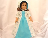 Turquoise on white print , long dress for 18 inch dolls, with solid turquoise inset and white lace trim.
