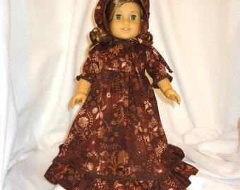 Brown print, long dress for 18 inch dolls, with brown mini pom pom trim.