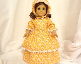 Yellow and pink floral doll dress for 18 in dolls long, double skirted, with white lace trim.