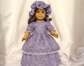 Purple on lilac print, long dress for 18 inch dolls, double skirted with sparkly white lace trim.