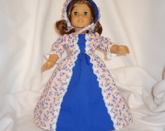 Royal blue on peachy pink print, long dress for 18 inch dolls, with solid royal blue inset and white lace trim.