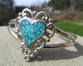 Vintage Bracelet / Cuff Turquoise Enamel Heart Surrounded by Ornate Silver Tone Metal Signed EJC 1980s