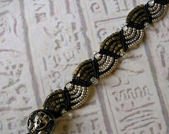 Micro macrame bracelet. Egyptian. Black matte metallic khaki and silver.