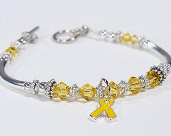 Yellow Ribbon Awareness Charm Bracelet: Sarcoma/Bone Cancer, Soldier support, Spina Bifida, Missing Children, Bladder Cancer. Get well