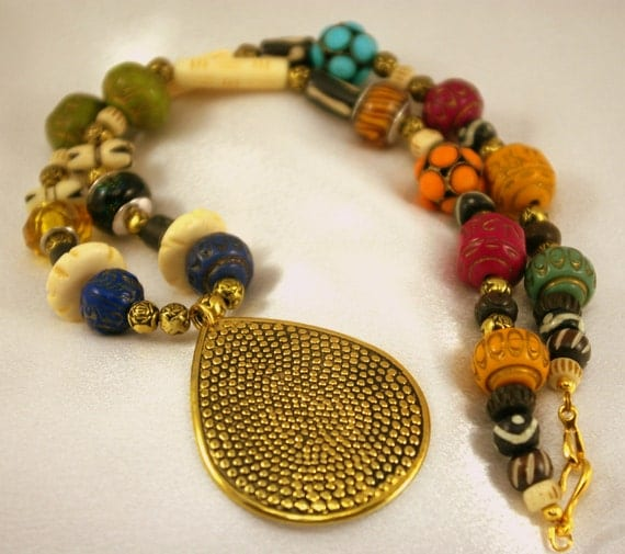 Tribal Inspired Necklace of many colorswith carved bone.  Fashion must have.  Color celebration.