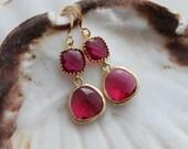 Bright ruby. Beautiful deep fuschia 16k gold framed glass stone earrings