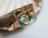 The Everyday collection. Stunning gold plated teal blue haze apatite glass stone dangle earrings
