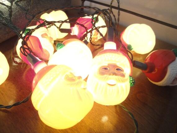 String of Blinking Santa Heads