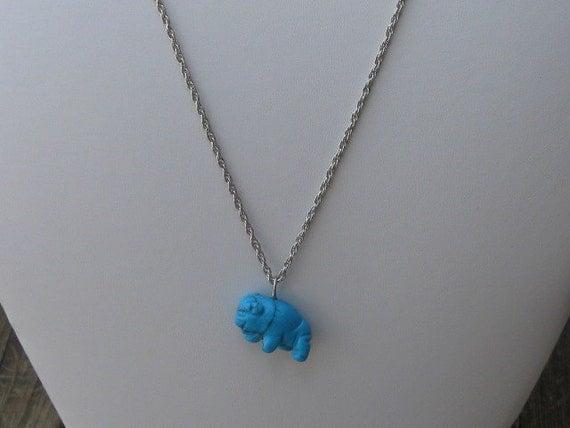 Genuine turquoise buffalo charm on silver chain