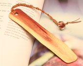 Hand made wooden bookmark for saving your place in your cookbook of Manzanita wood.