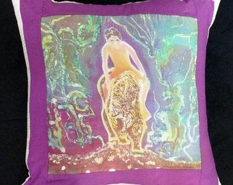 Kim riding a leopard on a silk, batiked, quilted,  pillow in rich purple and green shades