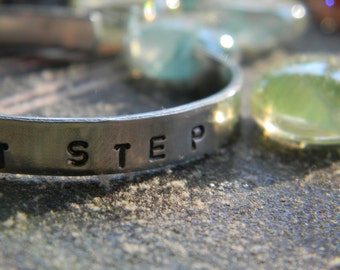 Take The First Step, silver hand stamped braclet