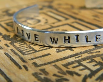 Live While You Are Alive,  a bracelet to remind you to take charge of the moment