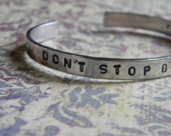 Don't Stop Believing.  wonderful  hand stamped silver bracelet.  One size fits all