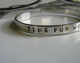 Time For Me To Fly.  A bracelet that reminds us all to move along