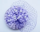 Lilac Flower Fascinator - lilac ribbon flowers and purple french veil adorned on an up-cycled plastic lid