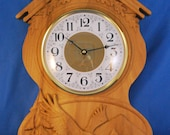 Wall clock with eagle in the mountains carving