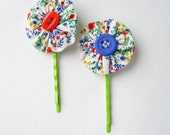 Pair of Bobby Pins with yoyos  in bright colorful floral cotton and red and blue bottons with green stems