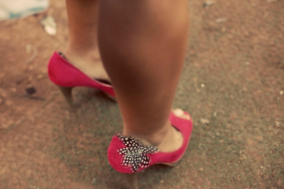 Vintage red shoes with feathers