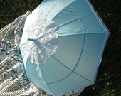 """Victorian Parasol, """"Blue Sky Parasol"""" trimmed in white lace."""